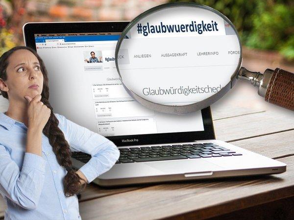 Eine Lupe zeigt einen vergrößerten Ausschnitt einer Internetseite auf einem Laptop. Davor steht eine fragend aussende Frau.